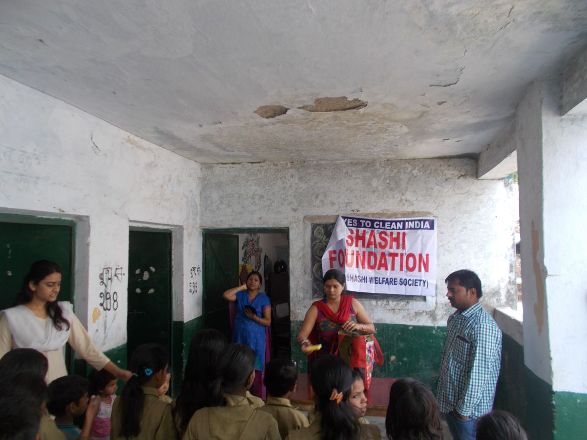 BHUPENDRA & SHITIKA TEACHING STEPS OF HAND WASH TO STUDENTS IN ANGANWADI SCHOOL LUCKNOW(U.P.)(6TH MAY 2015)