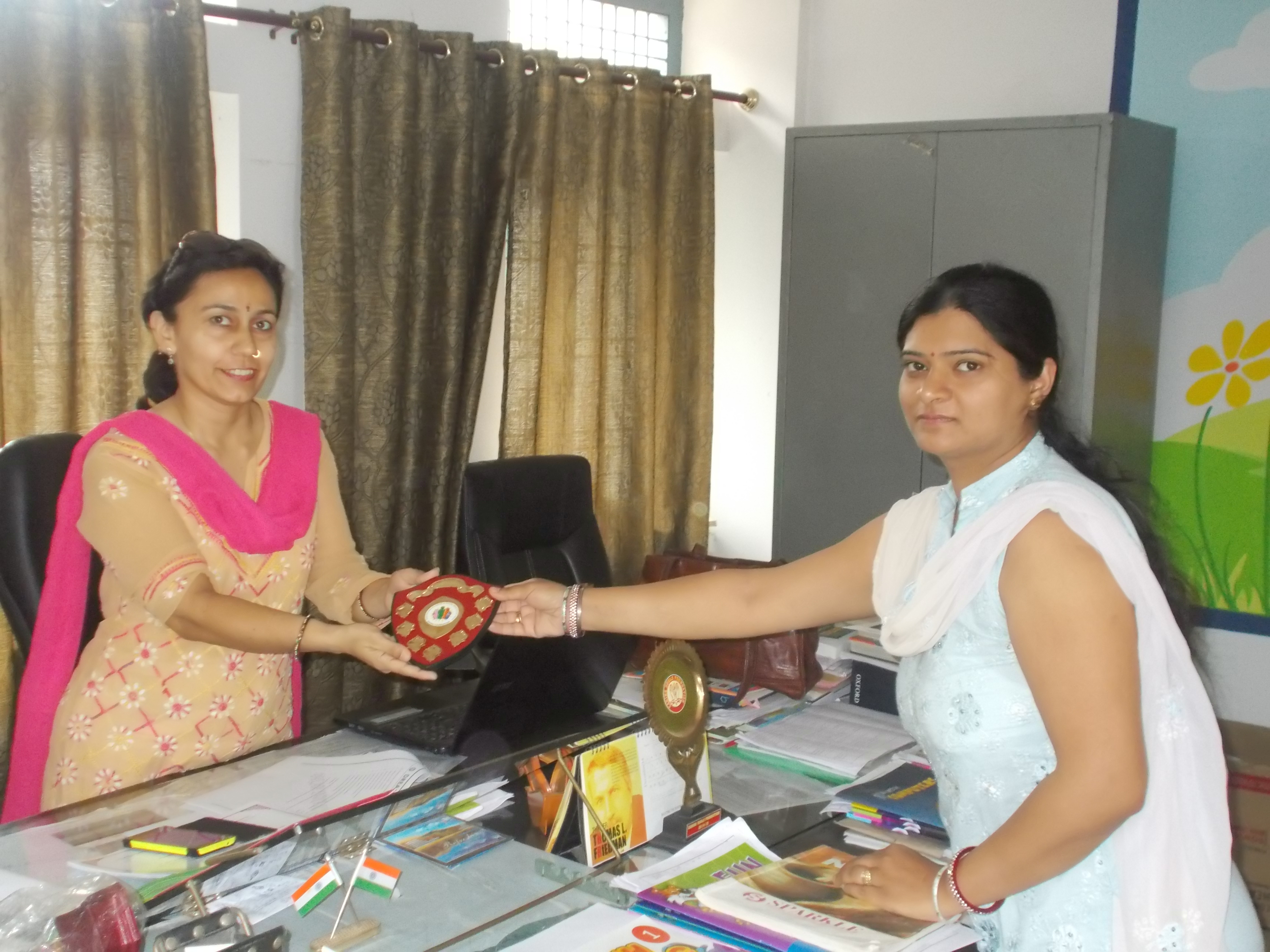 Shitika thanking the principal of school in Lucknow (u.p.) for her support in the awareness program held in her school